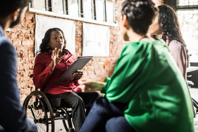 Businesswoman leading group discussion in office
