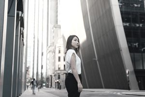 A woman stands on a city street