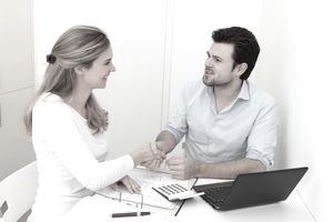 a woman shaking hands with a businessman