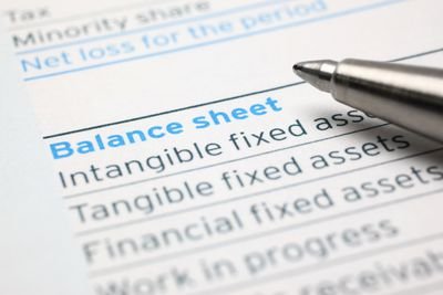 Balance sheet with pen on top