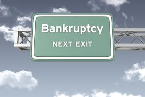 "Road Sign with words ""Bankruptcy Next Exit"""