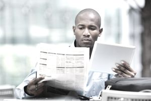 An investor looks over stock information.