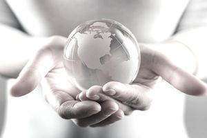 Midsection Of Woman Holding Globe