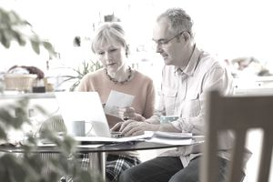 Elderly couple looking at pension information