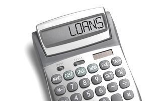 "A calculator with with the word ""LOANS"" spelled out"