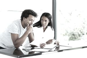 Couple reading notice of default on a credit card debt