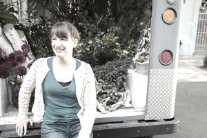 Portrait of florist sitting on back of delivery truck