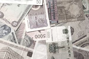 Assorted foreign currency scattered