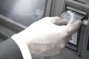 Inserting bank card into ATM to perform automated banking transaction