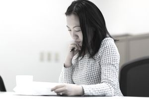 Young businesswoman reviewing papers