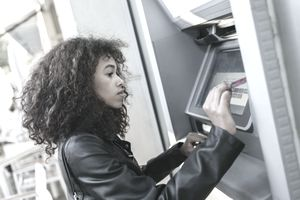 Woman using an ATM.
