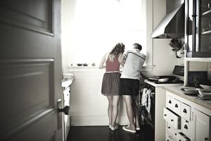 Couple looking out kitchen window