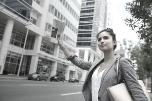 a young woman hailing a cab