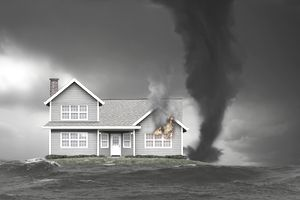 A illustration of a high-risk home on fire and also threatened by a tornado and rising flood waters