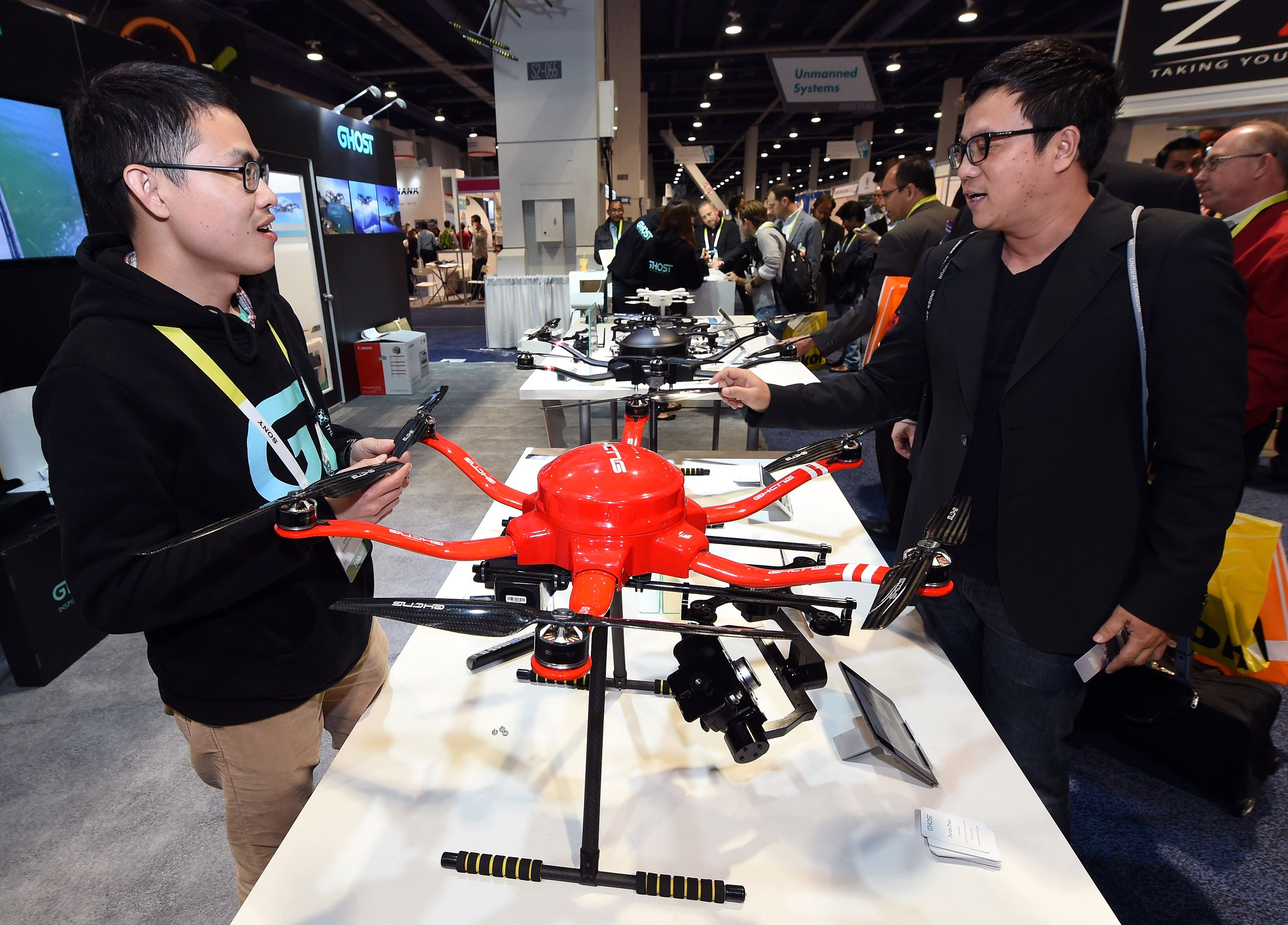 Consumer asking about drone at trade show