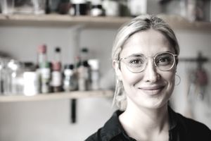 Saving Habits - Female Chef smiling wearing glasses
