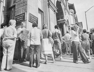 Depositors form a line to make withdrawals from a troubled S&L bank in Baltimore.