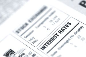 Small box in a newspaper containing interest rates info - stock photo