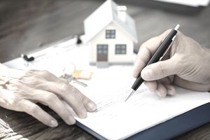 Real Estate Agent Helping Client In Filling a Property Deed