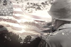 Senior USA army soldier overlay sunset, American flag.