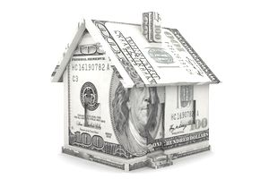 A paper house constructed of $100 bills