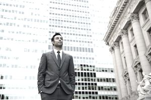 Businessman looking into distance in financial district