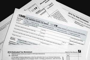 Stack of Form 1040 papers