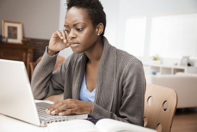 Stressed person working from home on computer