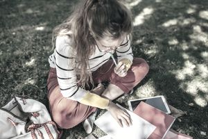 A student studies on campus grounds