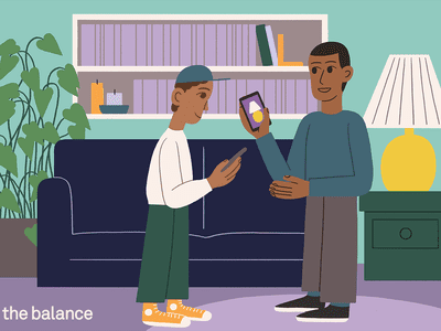 Image shows two young boys in a home looking at smartphones. On one screen is a lamp that also exists in the room.