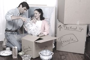 Couple packing their home