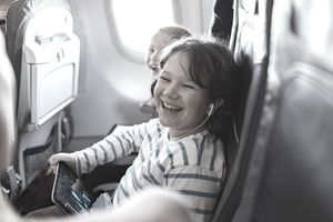 Family flying on an airplane.