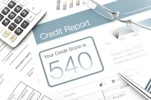 Closeup of a credit report with a 540 score