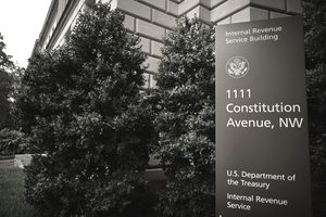 "Photo of the exterior of the IRS building in Washington. The close-up of the sign shows ""Internal Revenue Service Building"" and the address."