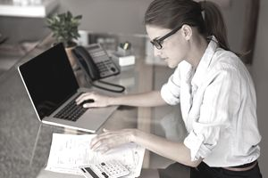 Woman on laptop preparing taxes