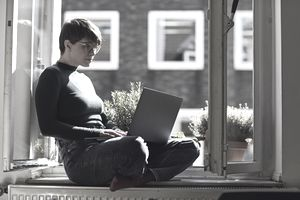 A business proprietor looks up tax information on a laptop