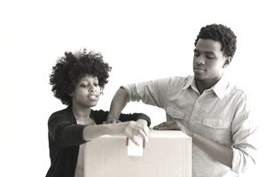 Black couple taping boxes
