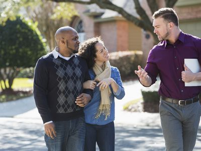 Black couple viewing a home for sale
