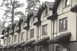 Street of new townhouses in forest close up