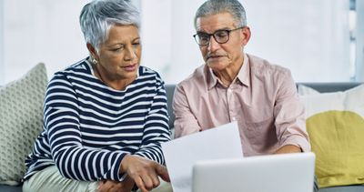Senior couple going over their retirement account at home
