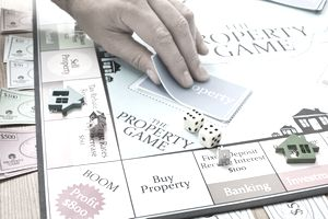 Player taking card from property board game
