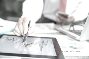 businessman using a mobile device to check stock market charts