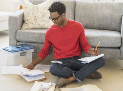 Man working on taxes papers