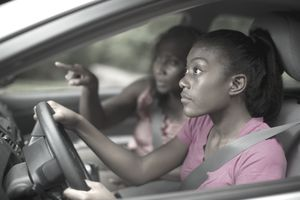 Teen learning to drive with mom