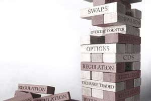 stack of blocks with financial terms stamped on them
