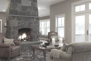 Home for sale in the winter with a burning fireplace