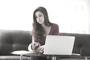 Woman frustrated reading financial documents