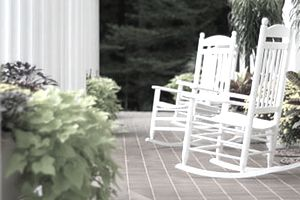 Set of retirement rocking chairs on a porch of a home with a mortgage