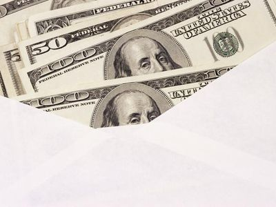 Money spilling from an envelope signifies an investor receiving a dividend payment