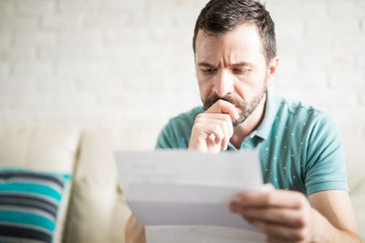 A recently laid-off IT employee contemplates what to do with his unemployment benefits.